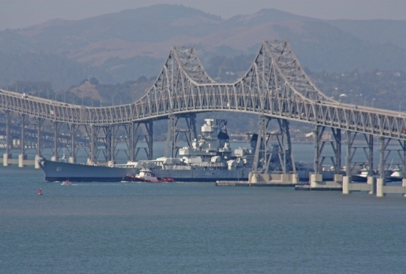 IOWA peeking out from under the Richmond-San Rafael bridge on SF bay. (Photo Courtesy of Bob Fish, USS HORNET Museum)