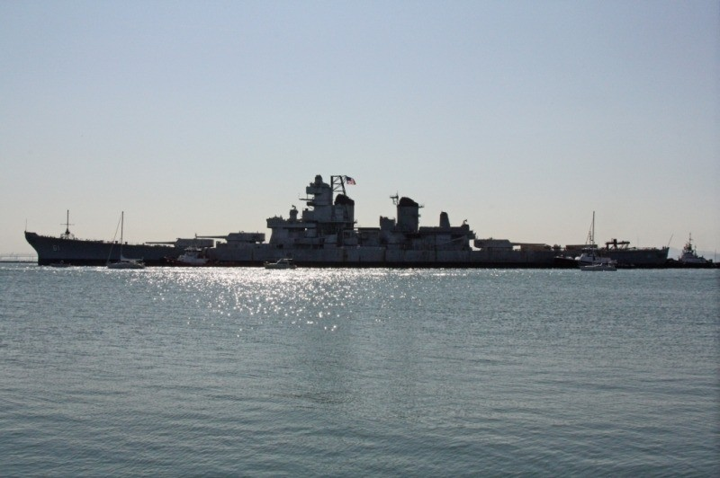 Silhouette of IOWA as she enters the Richmond inner harbor channel. (Photo Courtesy of Bob Fish, USS HORNET Museum)