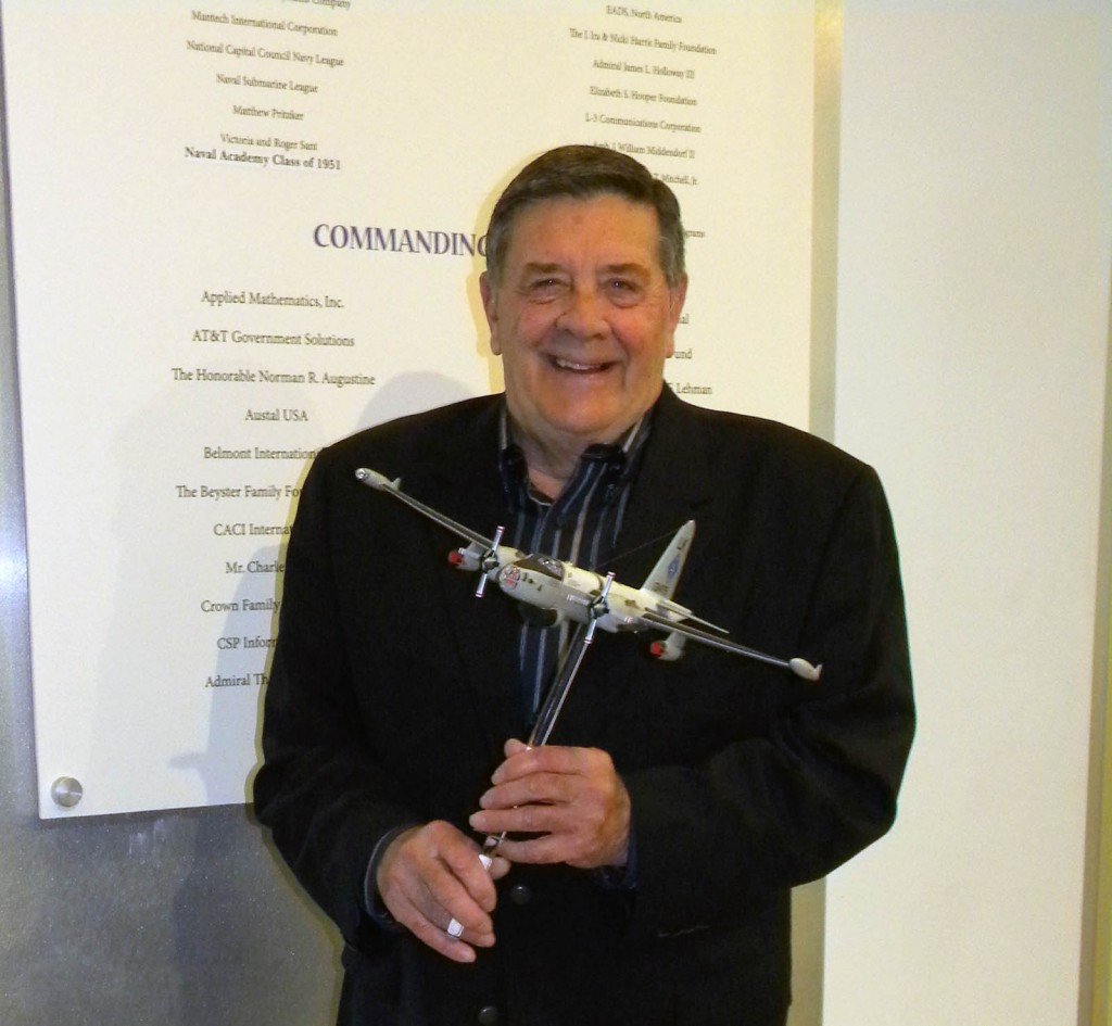 RADM P.D. Smith poses with the P2V-5 Neptune model he sponsored for the Cold War Gallery.