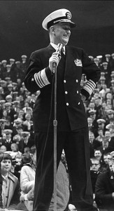 Chief of Naval Operations ADM Arleigh A. Burke, USN, addresses U.S. Naval Academy pep rally on 23 November 1960, on the eve of Army-Navy football game. NH 54900.