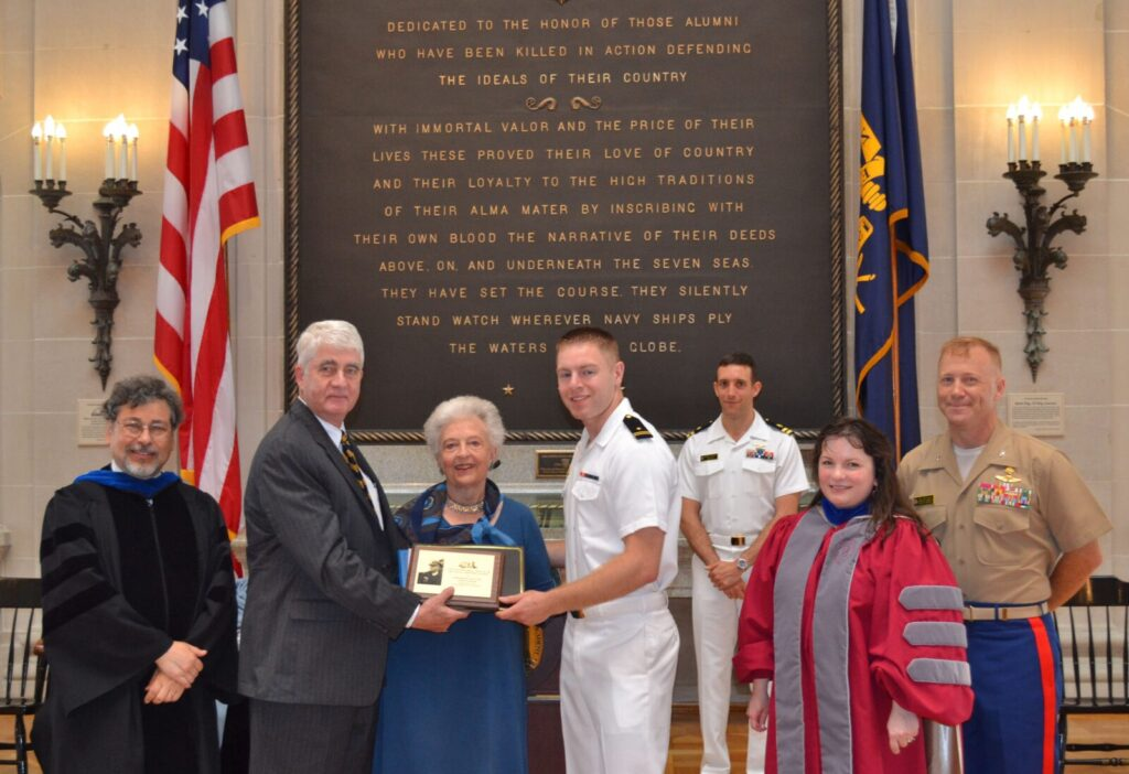 Presentation of the 2013 Beach Award. L to R: XXXXX, Captain Todd Creekman, Ingrid Beach, Midshipman First Class Daniel Ziminski, XXXXXXX, XXXXXXX