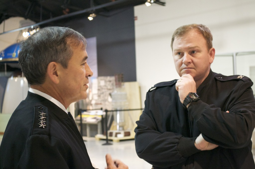 NHHC Director Captain Jerry Hendrix, USN talks with Admiral Harris inside the Cold War Gallery