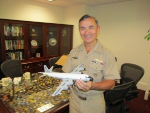Adm. Harris and the P-3A Orion model now in the Cold War Gallery