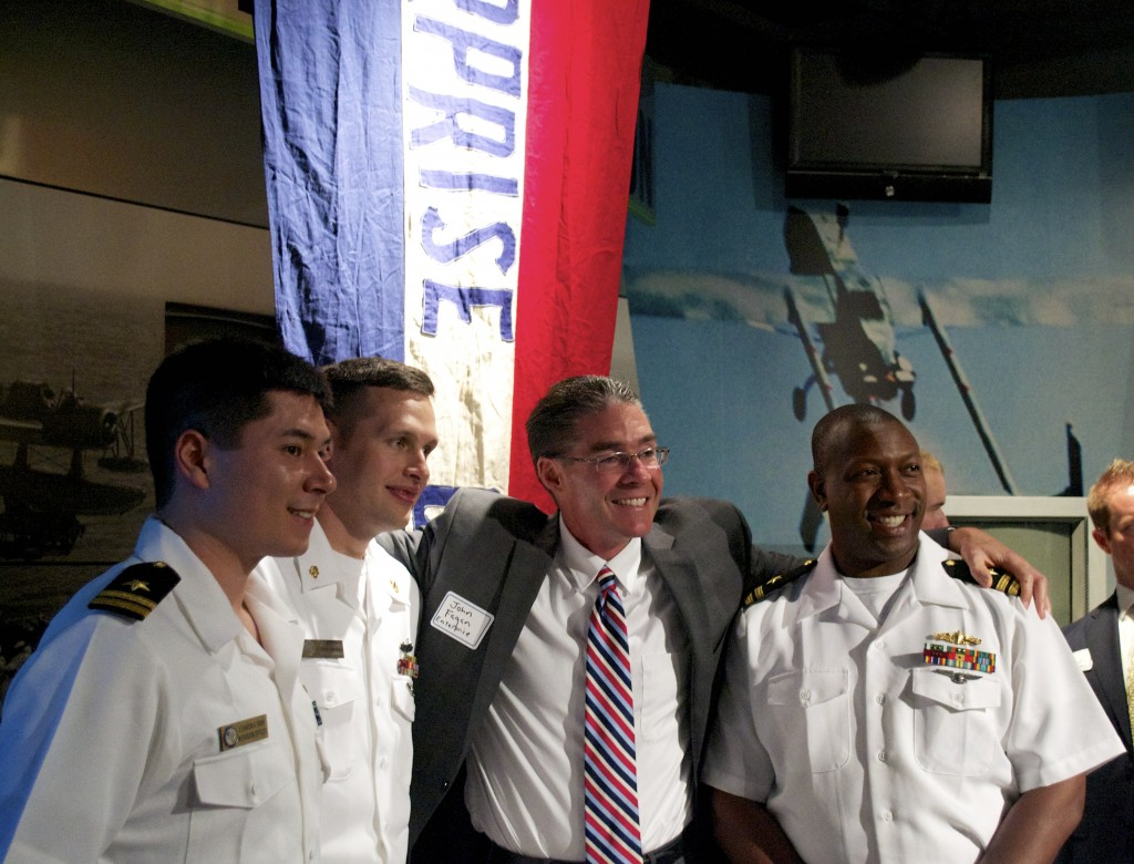 "NORFOLK, VA (May 6, 2014) An Enterprise Rent-A-Car Rep for the Norfolk area snaps a photo with current sailors of the ""Big E."" (NHF Photo by Matthew Eng/Released)"