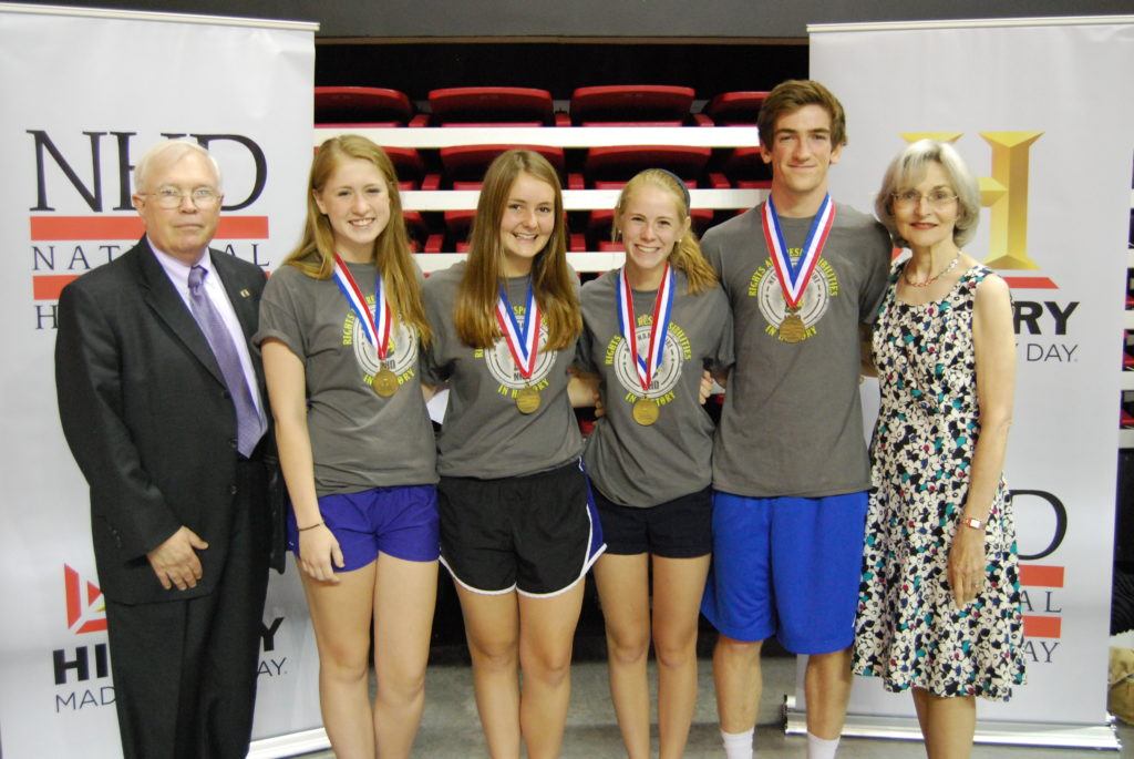 Captain Charles Chadbourn, USN (Ret.), Rosemary Coskey, and the Senior Division Winners from Exeter High School