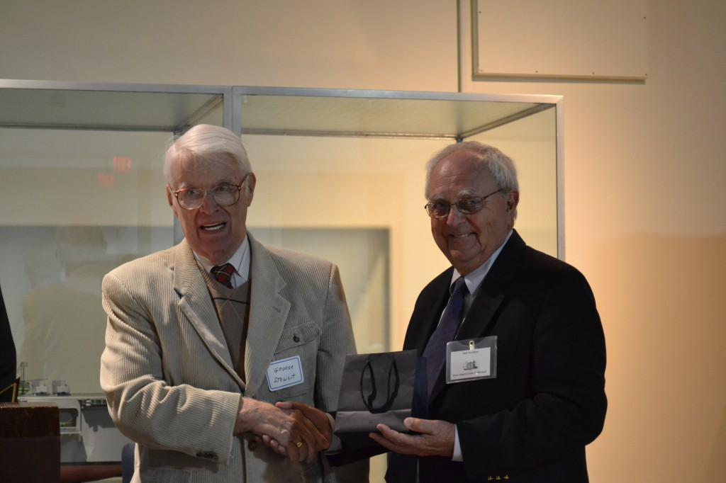 Captain George Stewart, USN (Ret.) accepts the Volunteer of the Year Award from Rear Admiral John T. Mitchell, USN (Ret.)