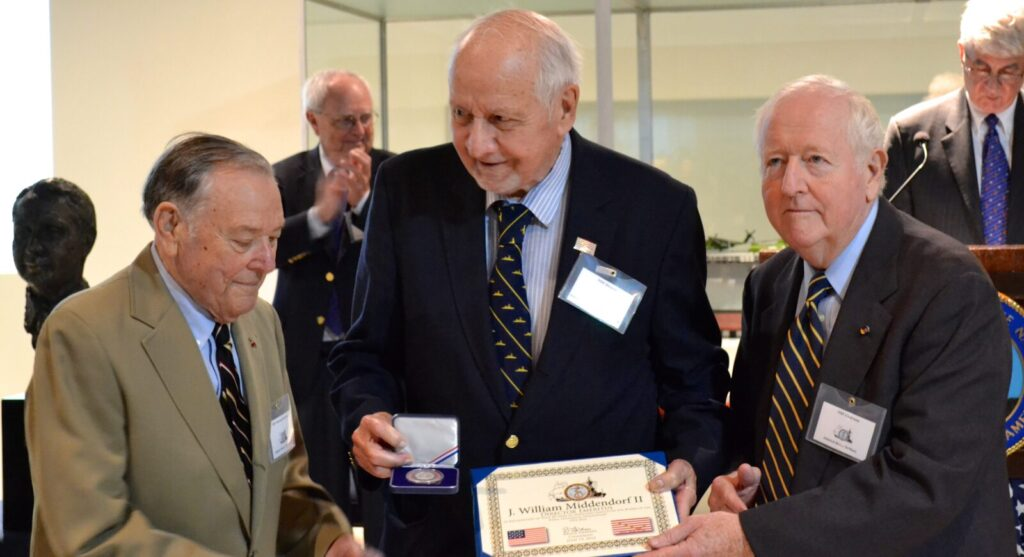 Admiral James L. Holloway III, USN (Ret.), Ambassador J. William Middendorf II, and Admiral Bruce DeMars, USN (Ret.)