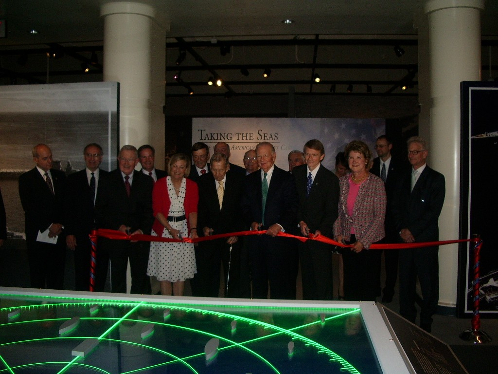 Susan Ford Bales (Left Center) cutting the ribbon at the exhibit opening (Creekman Photo).