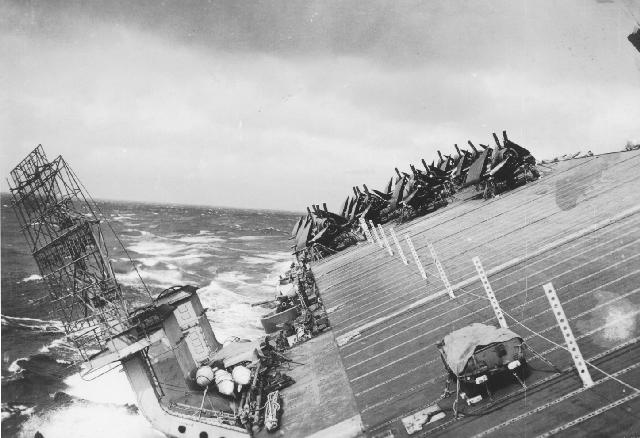 USS Cowpens lists during Typhoon Cobra