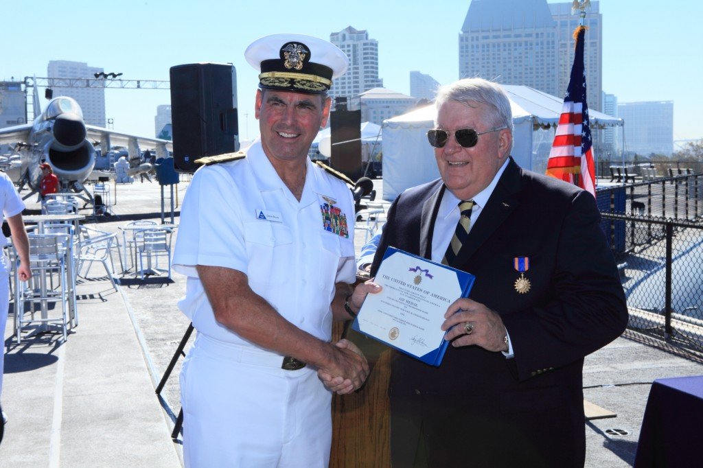 Rear Admiral William W. Pickavance, Jr. receives his Air Medal award from Vice Admiral David H. Buss, Commander, Naval Air Forces