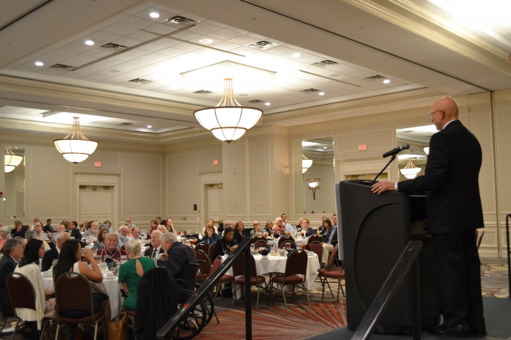 Admiral Robert J. Papp, Jr., USCG (Ret.) address crowd at a luncheon held during the 10th Maritime Heritage Conference. Admiral Papp was awarded the National Maritime Alliance Award of Distinction by celebrated author Clive Cussler.