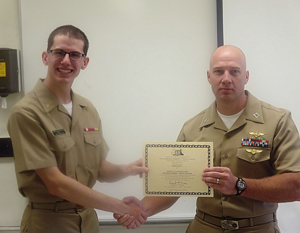 Regional winner Midshipman Knott receiving the award from Devin Bastemeyer.