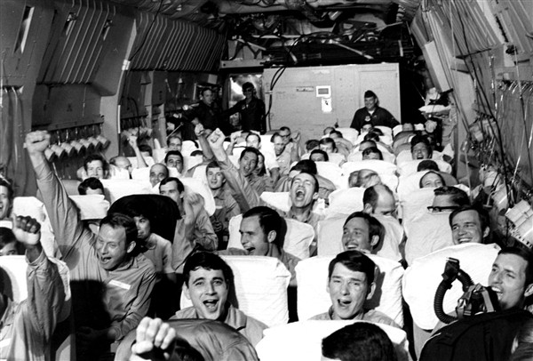 Newly freed prisoners of war celebrate as their C-141A aircraft lifts off from Hanoi, North Vietnam, on Feb. 12, 1973, during Operation Homecoming. (Defense.gov)