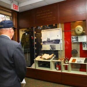 "Veteran Willard ""Bill"" Norberg admires River Vale's display honoring the USS ENTERPRISE (CV-6)"