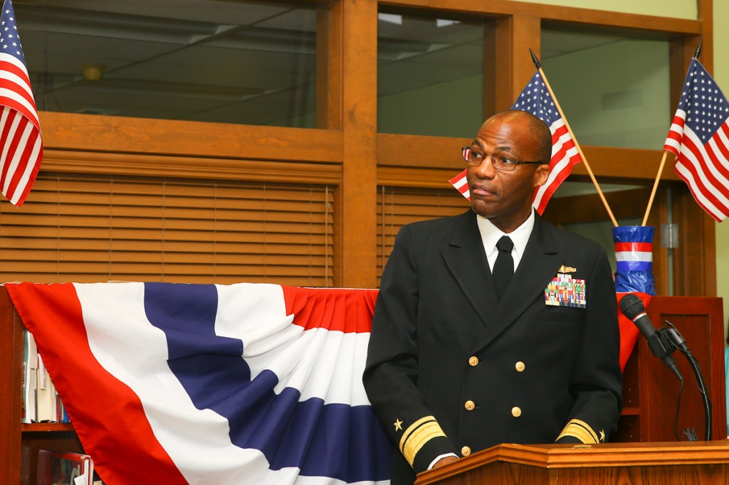 Rear Admiral Kelvin Dixon addresses those gathered to celebrate the legacy of ENTERPRISE