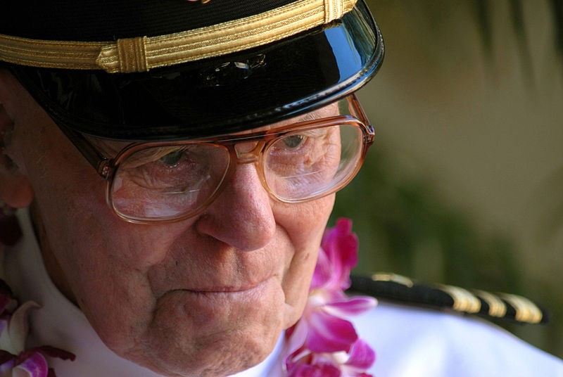 U.S. Navy USS Arizona survivor, retired Lt. Cmdr. Joseph Langdell pauses to collect his thoughts during an interview by a FOX News correspondent as he visits the USS ARIZONA Memorial Visitors Center. One hundred Sailors and Marines assigned to the Arleigh-Burke class guided-missile destroyers USS PAUL HAMILTON (DDG 60) and USS RUSSELL (DDG 59) and part of Combat Service Support Group 3, made up the honor cordon, which rendered honors to the survivors as they entered the USS ARIZONA Memorial Visitors Center at Pearl Harbor, Hawaii.