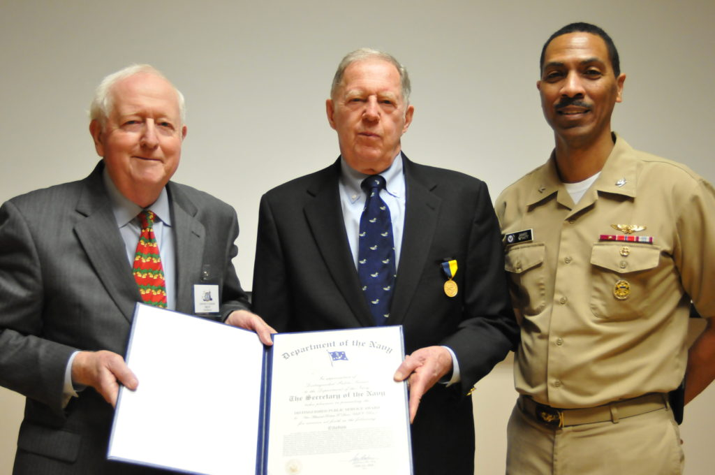 Chairman of the Naval Historical Foundation, Adm. Bruce DeMars, USN (Ret.) and Capt. James Wyatt, Deputy Director of the Navy Staff, present Vice Adm. Robert Dunn, USN (Ret.), center, with his Distinguished Public Service Award certificate at the National Museum of the U.S. Navy's Museum Education Center. Dunn received the award for his many efforts to promote the U.S. Navy's history throughout his 14 year tenure as president of the Naval Historical Foundation (NHF) from 1998-2012. (Photo by Mass Communication Specialist 1st Class Tim Comerford/Released)