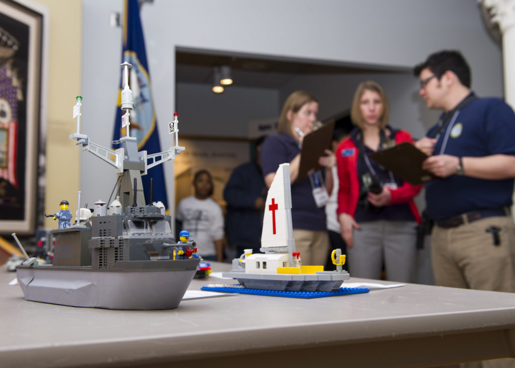 NORFOLK (Feb. 8, 2014) Judges examine an entry during the Brick-by-Brick Lego Shipbuilding Competition at the Hampton Roads Naval Museum. Participants in the annual competition used Lego building blocks to create ships while learning basic concepts of science, technology, engineering and mathematics. (U.S. Navy photo by Mass Communication Specialist Seaman Adam Austin/Released)