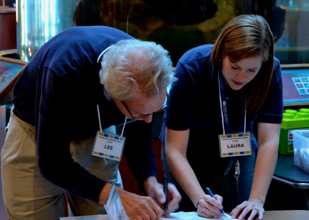 NORFOLK, VA (February 7, 2015) HRNM Deputy Educaiton Director Laura Orr works with HRNM ED Director Lee Duckworth sorting out volunteer lists on the morning of the event. (Photo by Matthew Eng/NHF/Released)