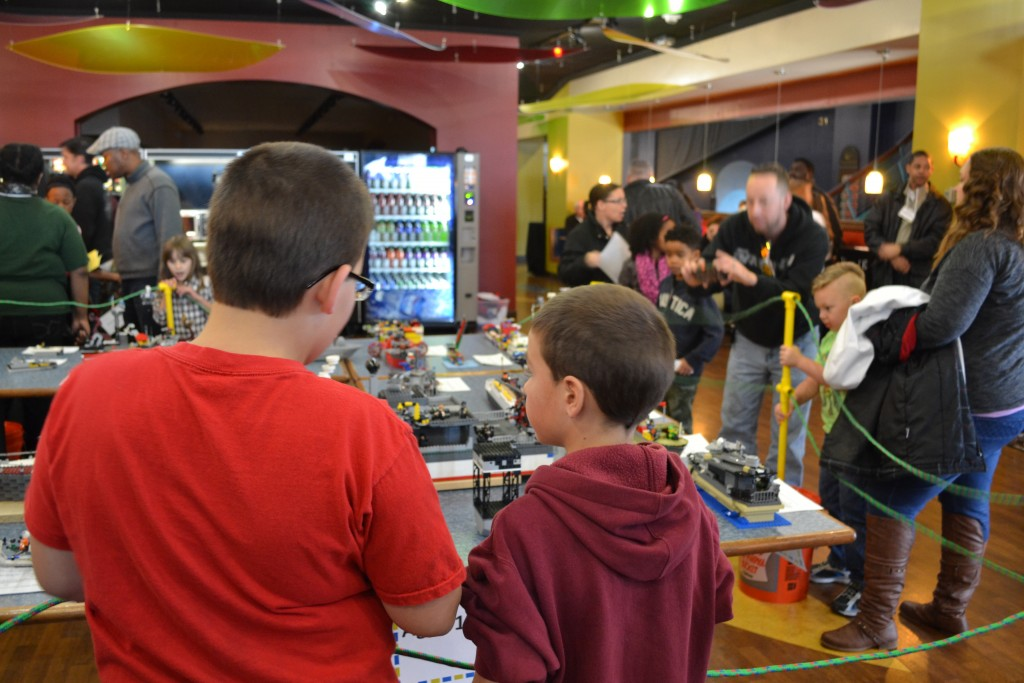 NORFOLK, VA (February 7, 2015) Guests at the Fourth Annual LEGO Shipbuilding Event and Competition look at contestant models in the 10-12 age category. The event was held at the Hampton Roads Naval Museum inside Nauticus. (Photo by Matthew Eng/NHF/Released)