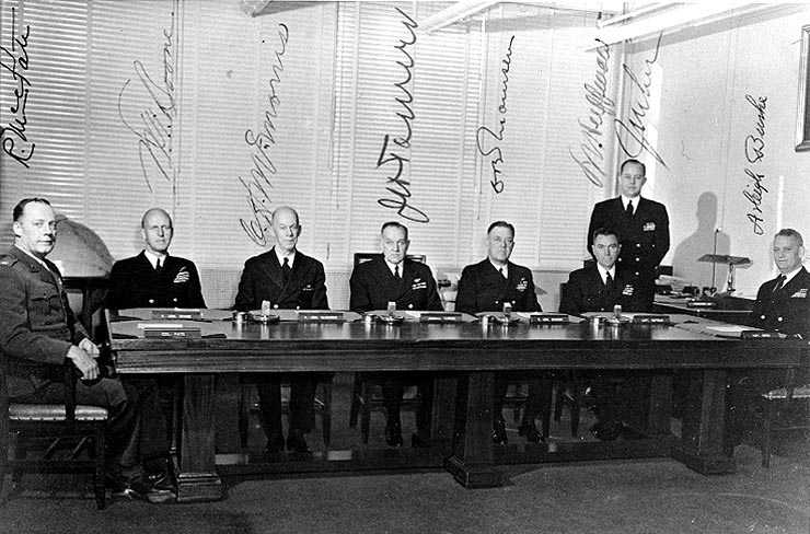 The General Board of the U.S. Navy in November, 1947. From left to right: Colonel Randolph M. Pate; Admiral Walter F. Boone; Admiral Charles H. McMorris; Admiral John H. Towers; Rear Admiral Charles B. Momsen; Captain Leon J. Huffman; Commander J.M Lee; Captain Arleigh A. Burke (USN Photo/Wikimedia Commons)
