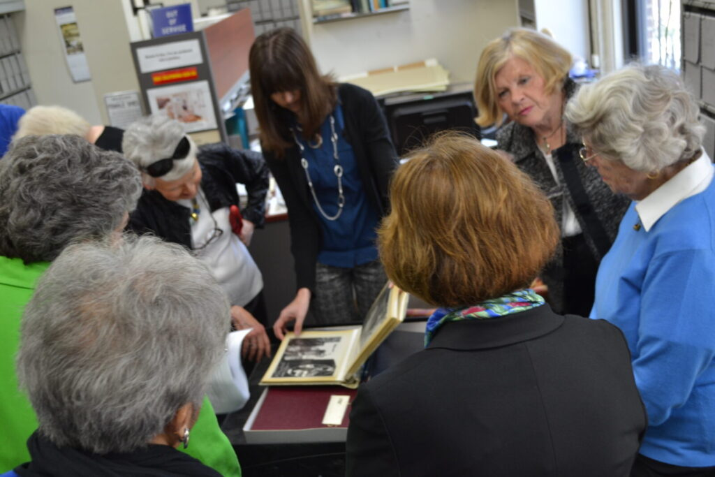 Lead archivist Lisa Crunk shows some of the sponsors materials within their collection.