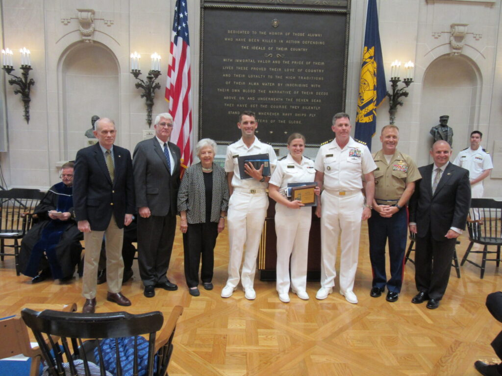 LCDR Tom Cutler, USN (Ret.), U.S. Naval Institute; CAPT Todd Creekman, USN (Ret.), NHF; Mrs. Ingrid Beach; Midshipman First Class Philip Youngberg; Midshipman First Class Dana Petersen; CAPT Craig Felker, USN, History Department Chairman; COL Paul Montanus, Humanities and Social Sciences Division Director; Dr. Andrew Phillips, Academic Dean