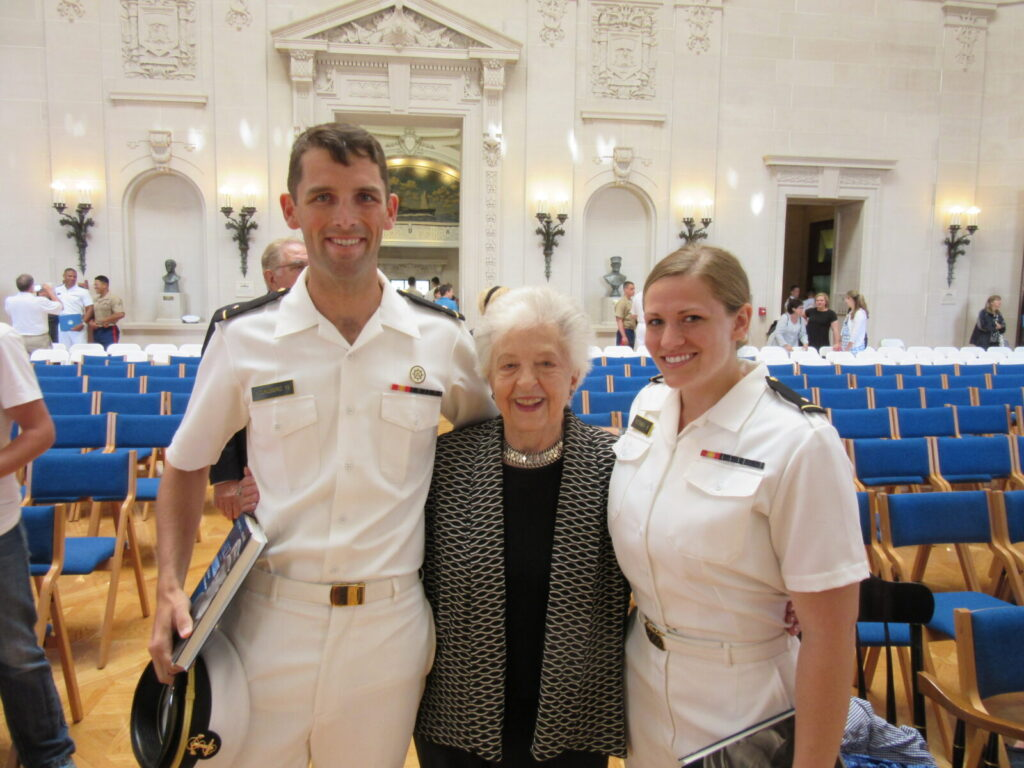 Midshipman First Class Philip Youngberg (left) and Midshipman First Class Dana Petersen (Right) pose for pictures with Mrs. Ingrid Beach at the 2015 Awards Ceremony.
