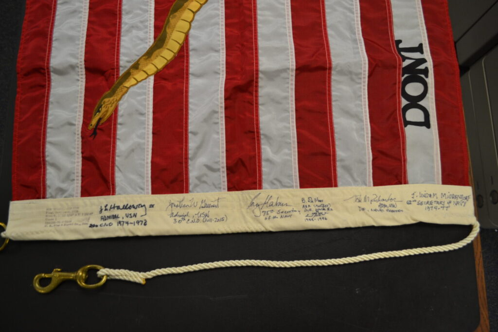 1975 Navy Jack signed by Holloway, Greenert, Mabus, Richardson, DeMars, and Middendorf (Photo by NHF/Matthew Eng/Released)