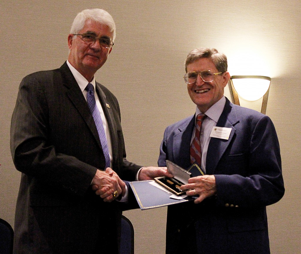 Dr. Michael Crawford receiving his 2015 Article of the Year Award at the NHF Awards Banquet Friday night. (NHF Photo by Matthew Eng/Released)