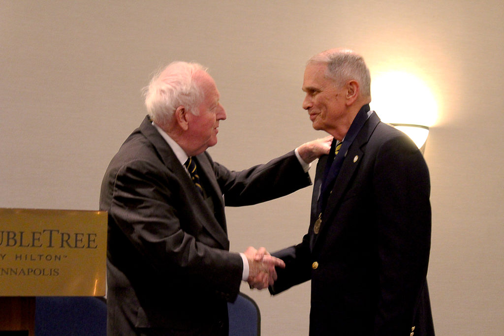 NHF Chairman Admiral Bruce DeMars, USN (Ret.) presents the Knox Medal to LCDR Thomas J. Cutler, USN (Ret.) at a banquet held on Friday evening. (NHF Photo by Matthew T. Eng/Released)