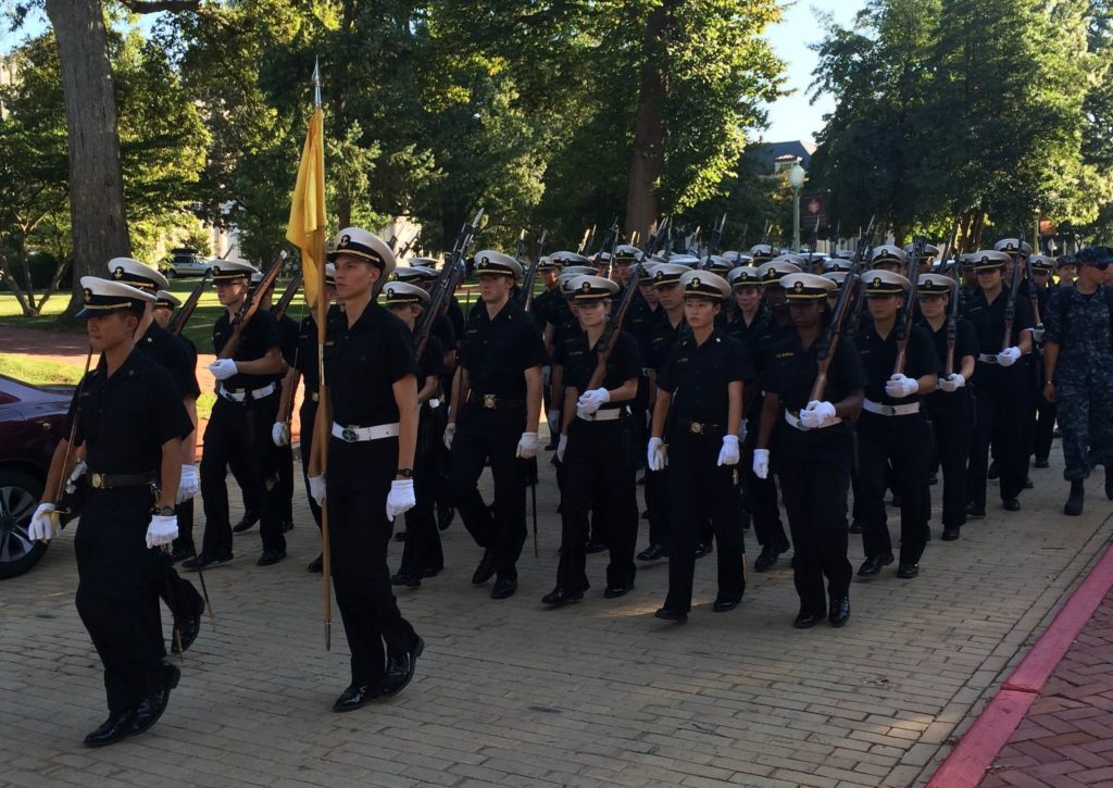 Midshipman march outside of a reception held at the Naval Academy Museum at the 2015 McMullen Naval History Symposium.