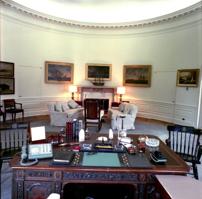 View from behind the President's desk in the Oval Office, White House, Washington, D.C. (JFK Presidential Library and Museum/Image # JFKWHP-KN-C18712-A)
