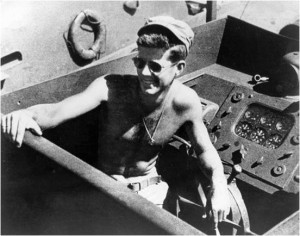 110529-O-ZZ999-007 FILE PHOTO (circa 1943) Lt.j.g. John F. Kennedy aboard the PT-109. (Photo courtesy the John F. Kennedy Presidential Library and Museum, Boston/Released)