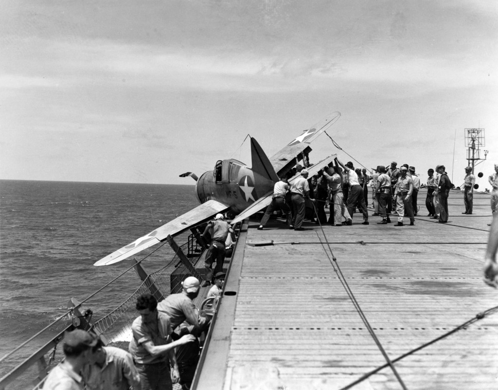 Photo #: 80-G-12906 Brewster F2A-3 Buffalo fighter, of Marine Fighting Squadron 211 (VMF-211) Rests in the flight deck gallery netting after suffering landing gear failure while landing on board USS <em><p id=