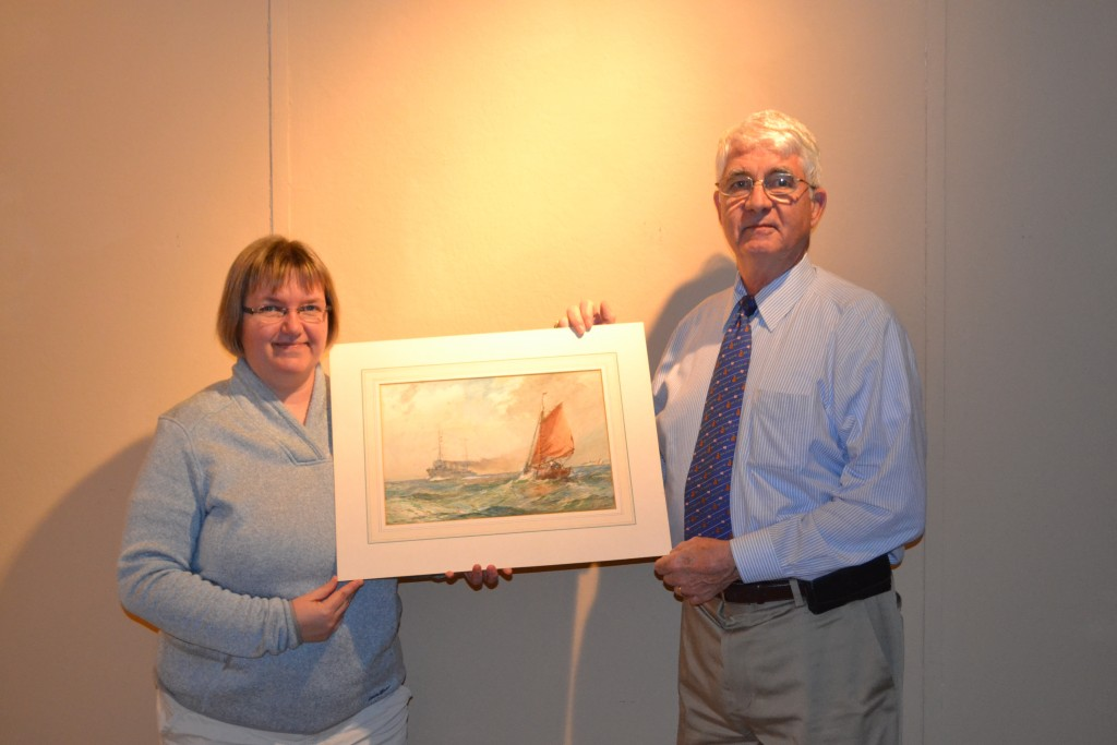 NHF Executive Director Captain Todd Creekman, USN (Ret.) poses with the Gribble watercolor with NHHC Navy Art Curator Pam Overmann (NHF Photo/Matthew Eng)