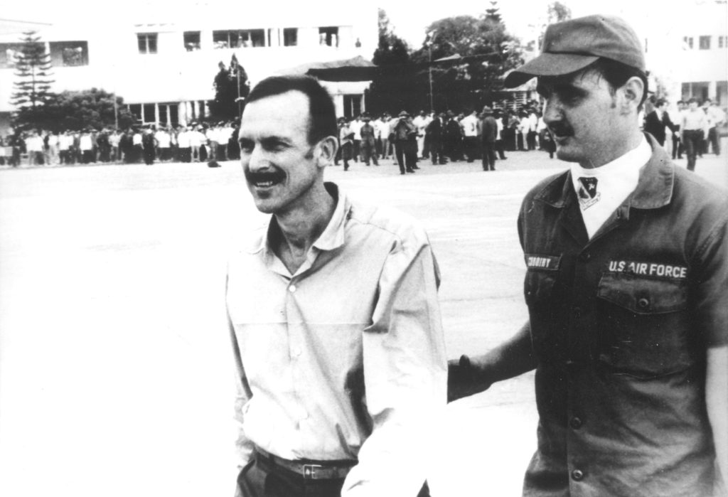 Commander Coskey escorted to airplane at Hanoi's Gia Lam Airport, 1973.