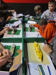 Visitors build LEGO ships designed by HRNM staff members for this year's event. (Photo by John Paulson/NHF/Released)