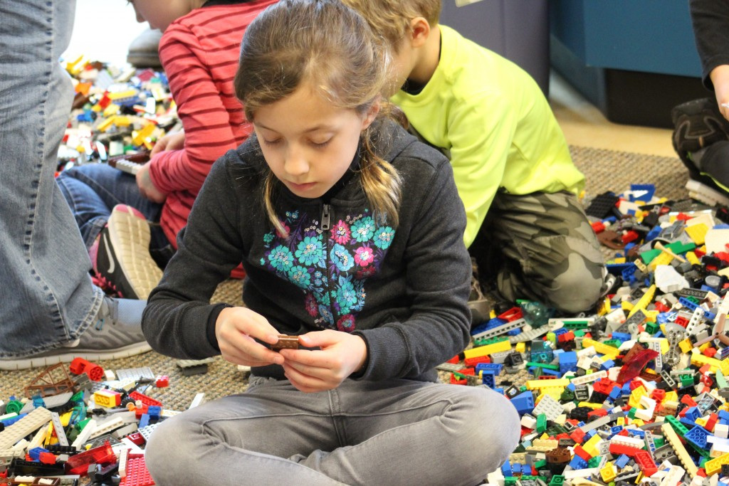 "A visitor to last week's LEGO Shipbuilding event at the Kalmar Nyckel Foundation builds a ship in the ""free play"" area (NHF Photo/Matthew Eng/Released)"