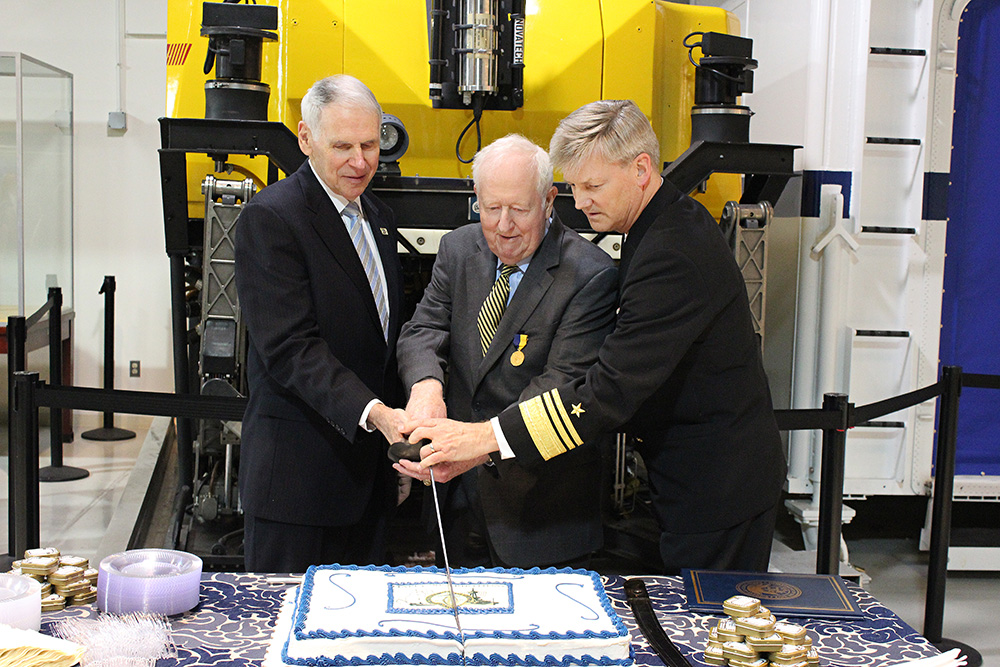 NHF Chairman Adm. William J. Fallon, USN (Ret.), NHF Chairman Emeritus Adm. Bruce DeMars, USN (Ret.), and Director of the Navy Staff, Vice Admiral Robert Thomas, USN cut the NHF birthday cake.