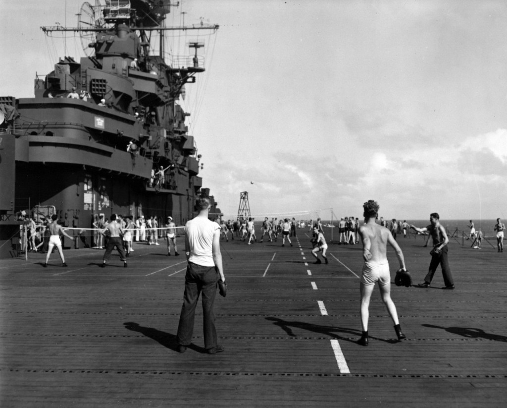 Though most ships did not have enough space for a baseball diamond, ballgames while on dry land - and games of catch while at sea - kept sailors in shape. Baseball games were even played on the deck of aircraft carriers. (Puget Sound Naval Museum)