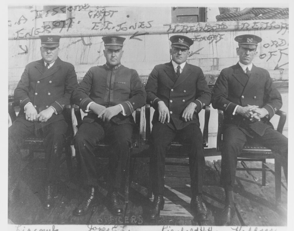 Ship's Officers at San Diego, California, circa early 1921. They are (from left to right): Machinist Louis A. Liscomb, Engineering Officer; Lieutenant Ernest L. Jones, Commanding Officer; Boatswain Harvey H. Reinbold, Executive Officer; and Boatswain Roy E. Hoffses, Ordnance Officer. All were lost when Conestoga disappeared after leaving San Diego in March 1921. Courtesy of W.P. Burbage, 1970. U.S. Naval History and Heritage Command Photograph. Related Content