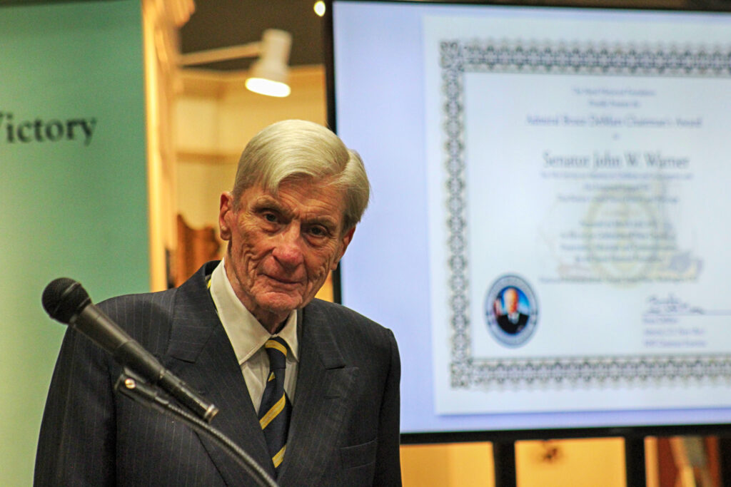 Senator John Warner with the Chairman's Award in the background. (NHF Photo)