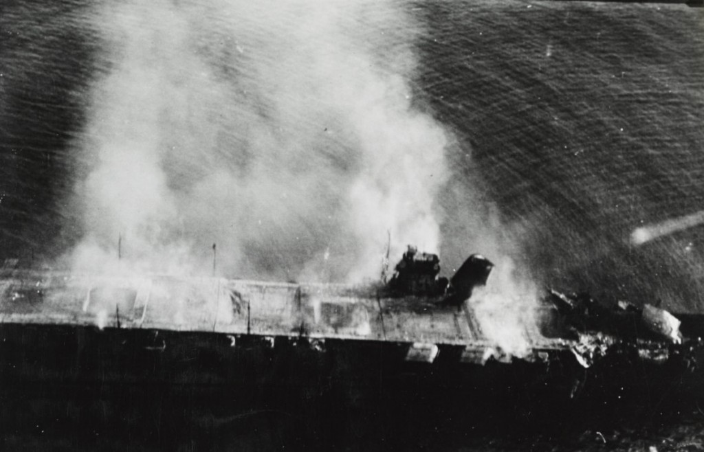 Japanese aircraft carrier Hiryu burning, shortly after sunrise on 5 June 1942, a few hours before she sank.  (NHHC Photo # NH 73064)
