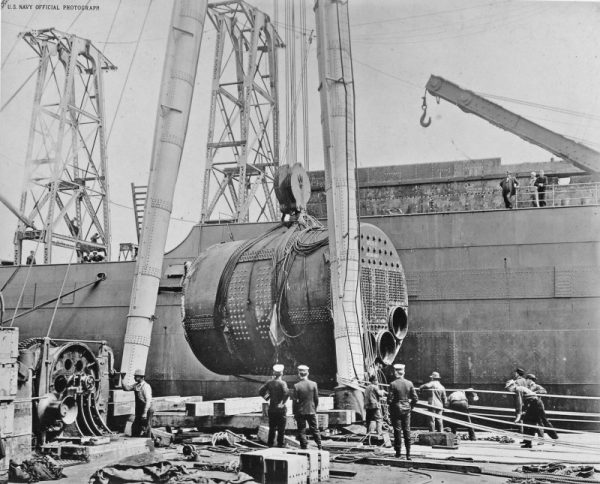 One of Jupiter's boilers being lifted aboard for installation while fitting out at Navy Yard Mare Island, circa 1912-13. Navy Yard Mare Island photo (NavSource)