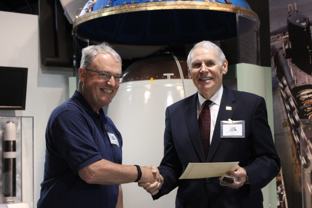 Captain Paulson receives his award from NHF Chairman William Fallon (NHF Photo/Matthew Eng/Released)