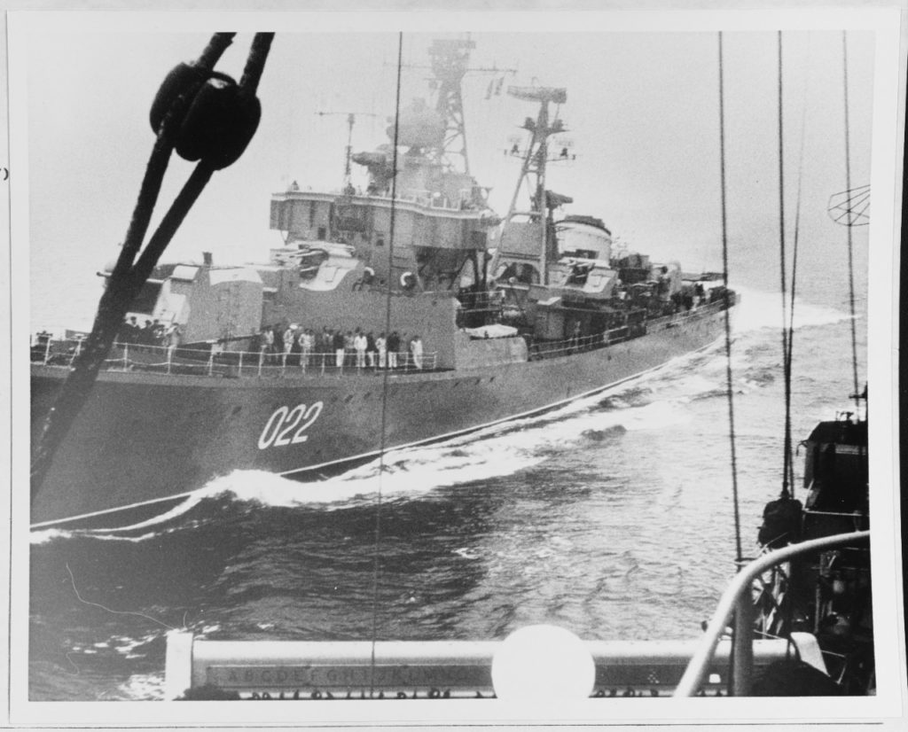 "The Soviet ""Kotlin""-class destroyer BESSLEDNYI (pennant number 022, at left), seen from the deck of the American destroyer USS WALKER (DD-517), was photographed by a U.S. Navy cameraman a short time before the two ships collided in the Sea of Japan during the morning of 10 May 1967. (NHHC Photo # K-36401)"