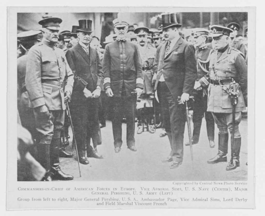 This image was originally taken on 8 June 1917, upon Pershing's arrival.  Note that he arrived in three star status and Sims is standing in the uniform he had made which features two stars.  Pershing was two years junior to Sims by lineal precedence, but received his promotion to four stars while Sims received his promotion in July to three stars (with the promotion back dated to May according to the register).  In essence, Pershing always outranked Sims as the AEF commander, but Sims held the chair as senior naval representative on the Allied Naval Council in London.  (NHHC Photo # NH 52790)