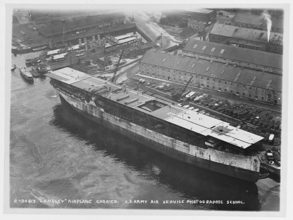 Under reconstruction from the collier JUPITER at Norfolk Navy Yard, Portsmouth, Virginia, circa late 1921. (NHHC Photo # NH 93538)