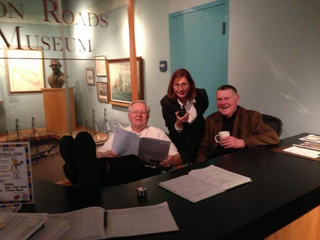 "Becky with volunteers Dick Hannah and Jim Reid at the famed ""front desk duty"" (HRNM Photo)"